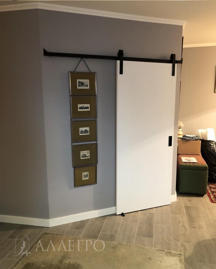 Дверь под покраску с раздвижным амбарным механизмом фото