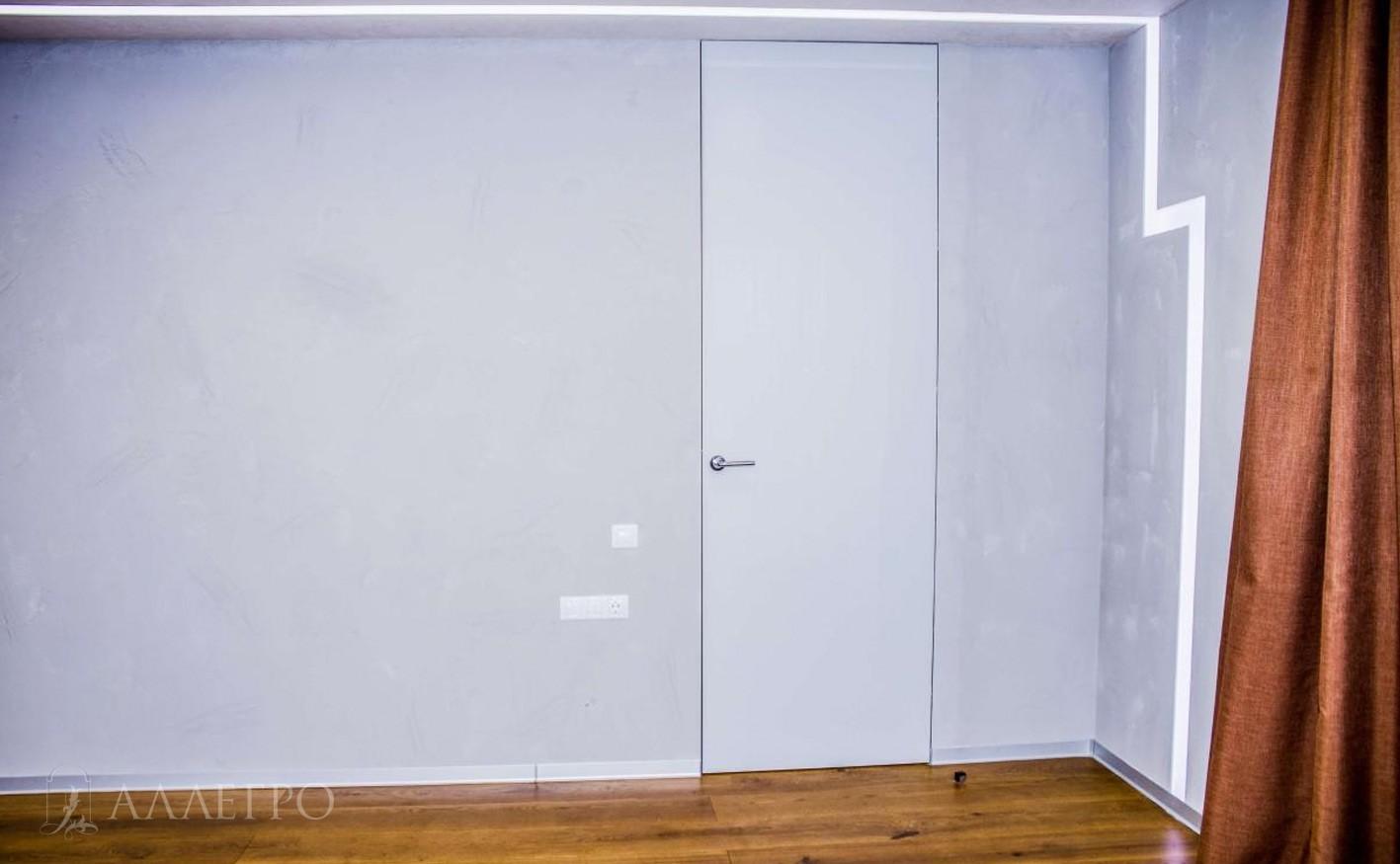 Нестандартная высота двери придает ей особенную эстетику